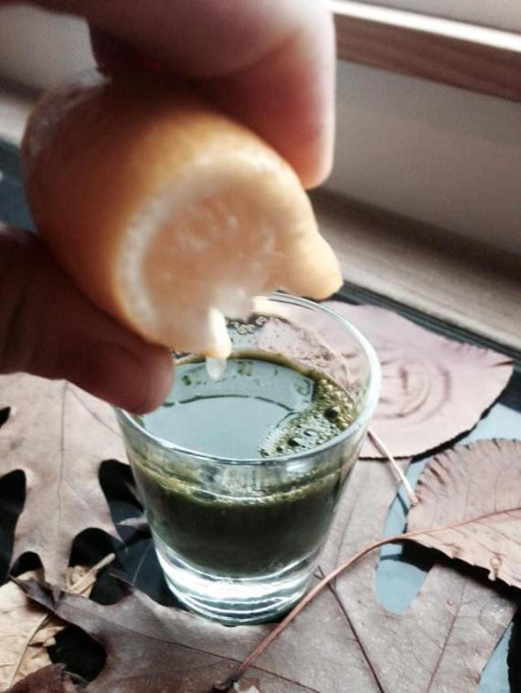 Raw Cannabis Juice with a squeeze of lemon.